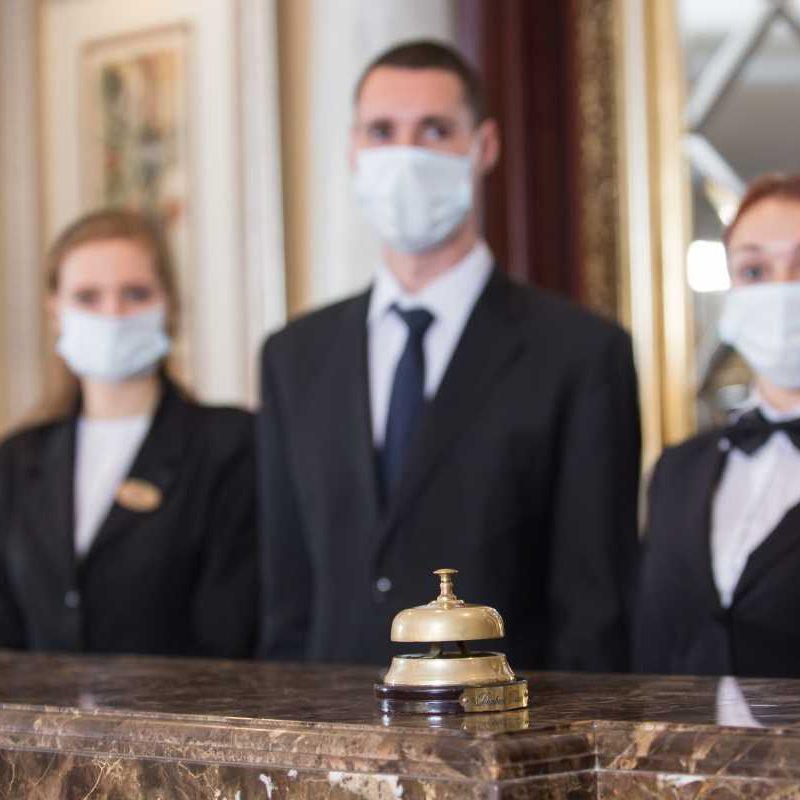 hotel-staff-serves-guests-medical-masks